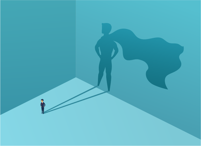 A professional is standing in an open area with their shadow projecting on the wall behind them. The shadow shows the figure of a super hero.